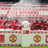 Manchester United celebrate with the tro